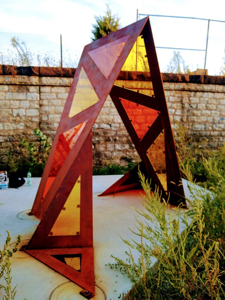 The completed shade sculpture! The multi-colored panels are a nod to the similarly multi-colored plexiglass used at the Kedzie Lake Green Line Station.