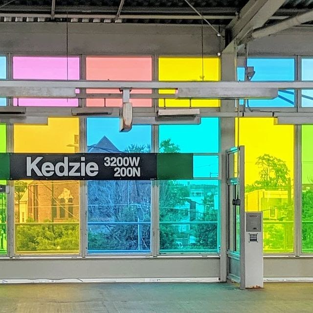 Photo of Kedzie and Lake Green Line stop. Colorful windows as the backdrop.