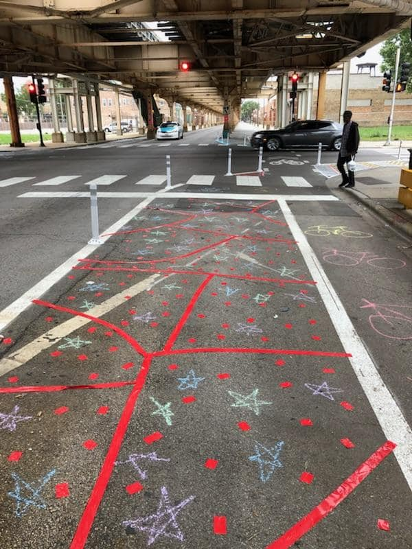 Colorful designs decorate the bike lane and increase visibility at the Lake and Kedzie intersection