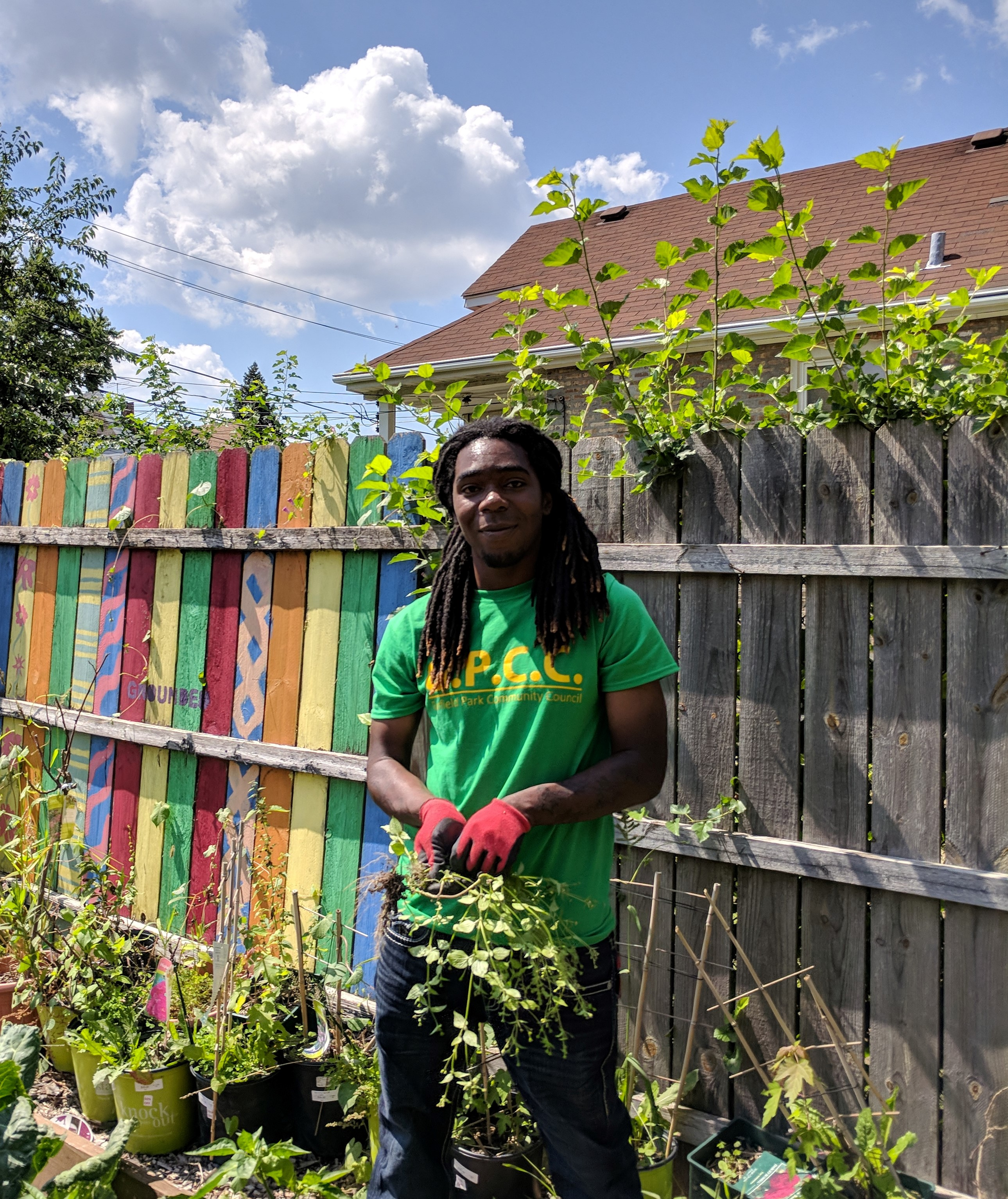 Youth Garden Corps member working in a local garden
