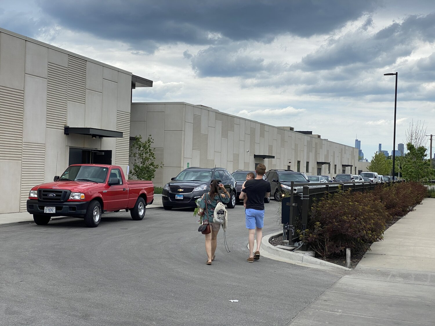 Drivers wait in line to purchase products at The Garfield Park Neighborhood Market in The Hatchery's parking lot on July 11. 2020. Photo by Mariah McBride.