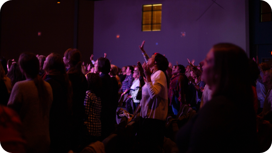 A group of people worshipping and praying.