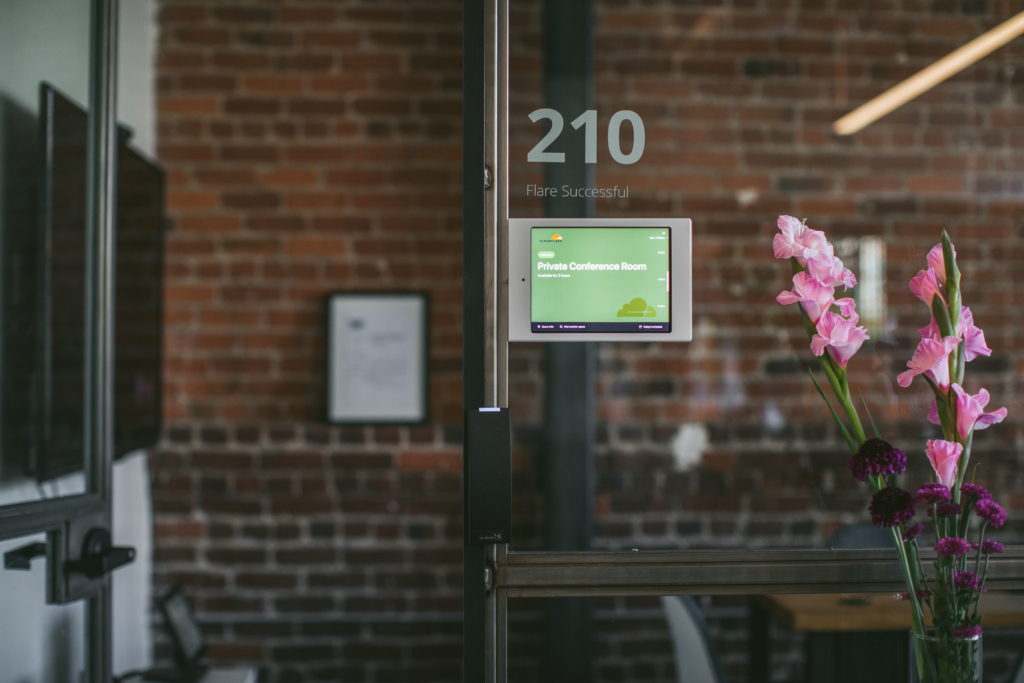 With room displays, employees must check in to meetings otherwise scheduling systems like Robin release the room to be recaptured by other employees who need it.