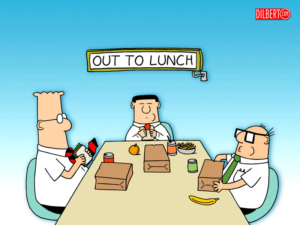 Dilbert business lunch with them eating sad paper bag lunches