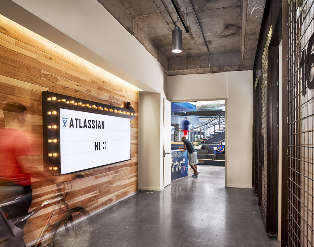 Incorporate customizable designs like Atlassian did in your workplace design strategy to give people a sense of ownership