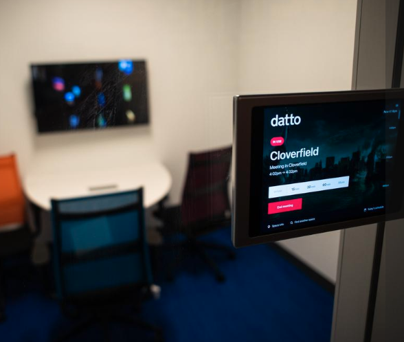 Datto using Robin's meeting room scheduling software with meeting room display software outside of a conference room