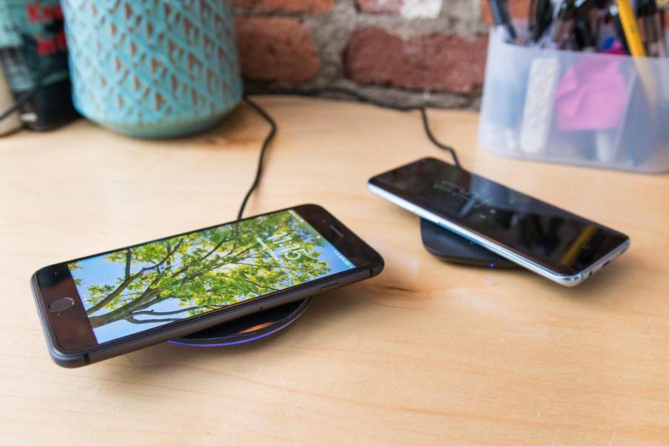 Wireless smartphone charging pads