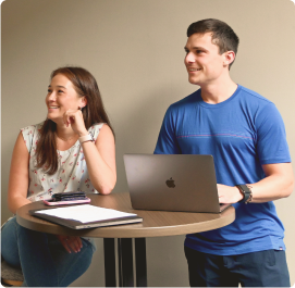 Two Robin Employees smiling in a meeting