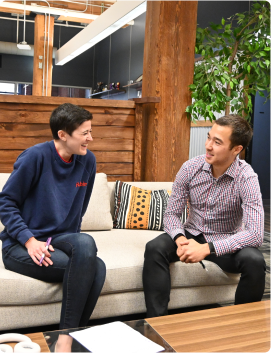 Two Robin employees smiling while talking