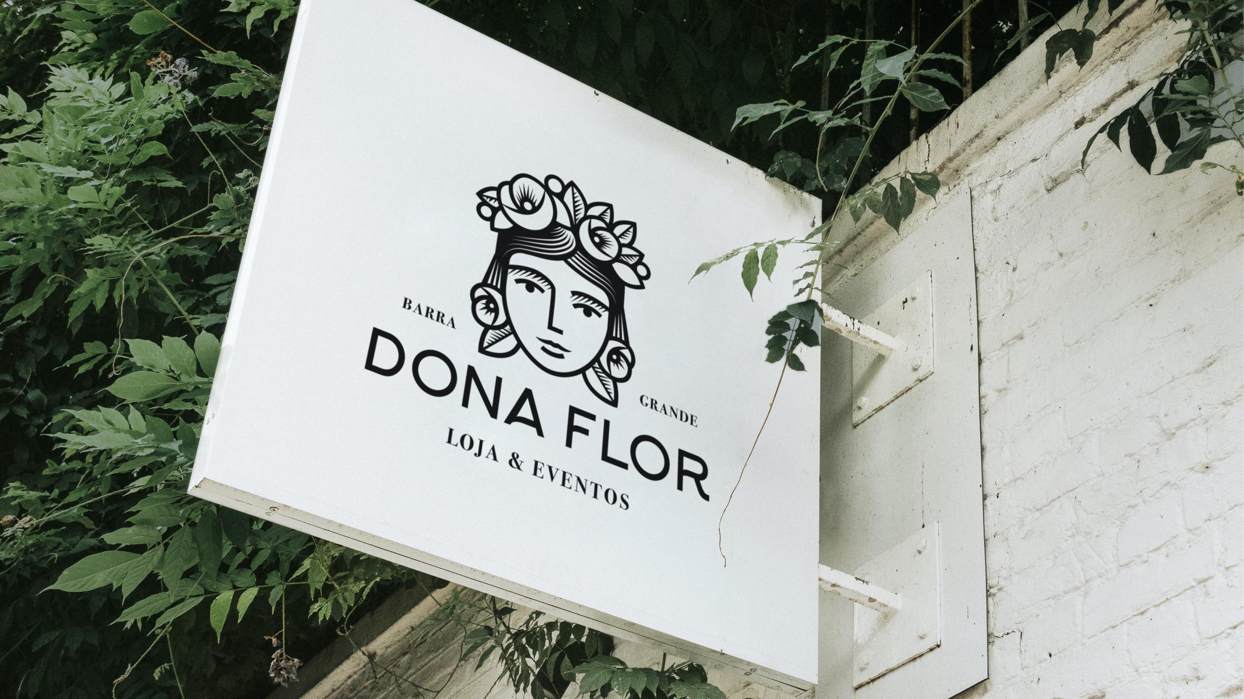 Logo von Dona Flor auf einem Ladenschild