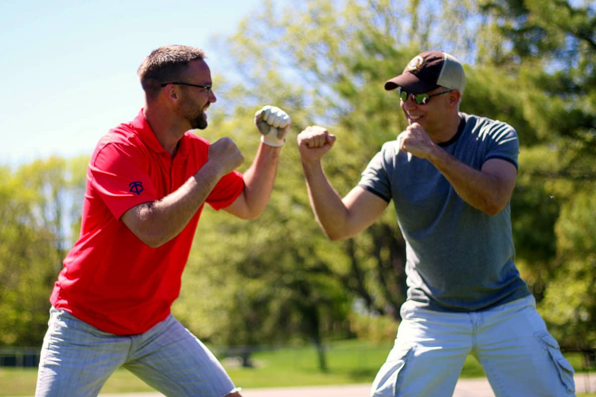 Two men facing off participating in group games