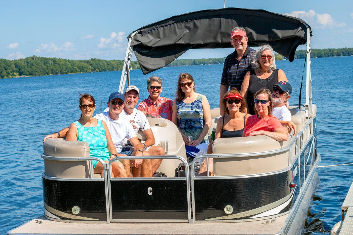 Group on a pontoon book on Bay Lake