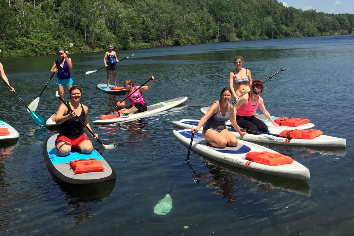 Women paddle boarding on Bay Lake