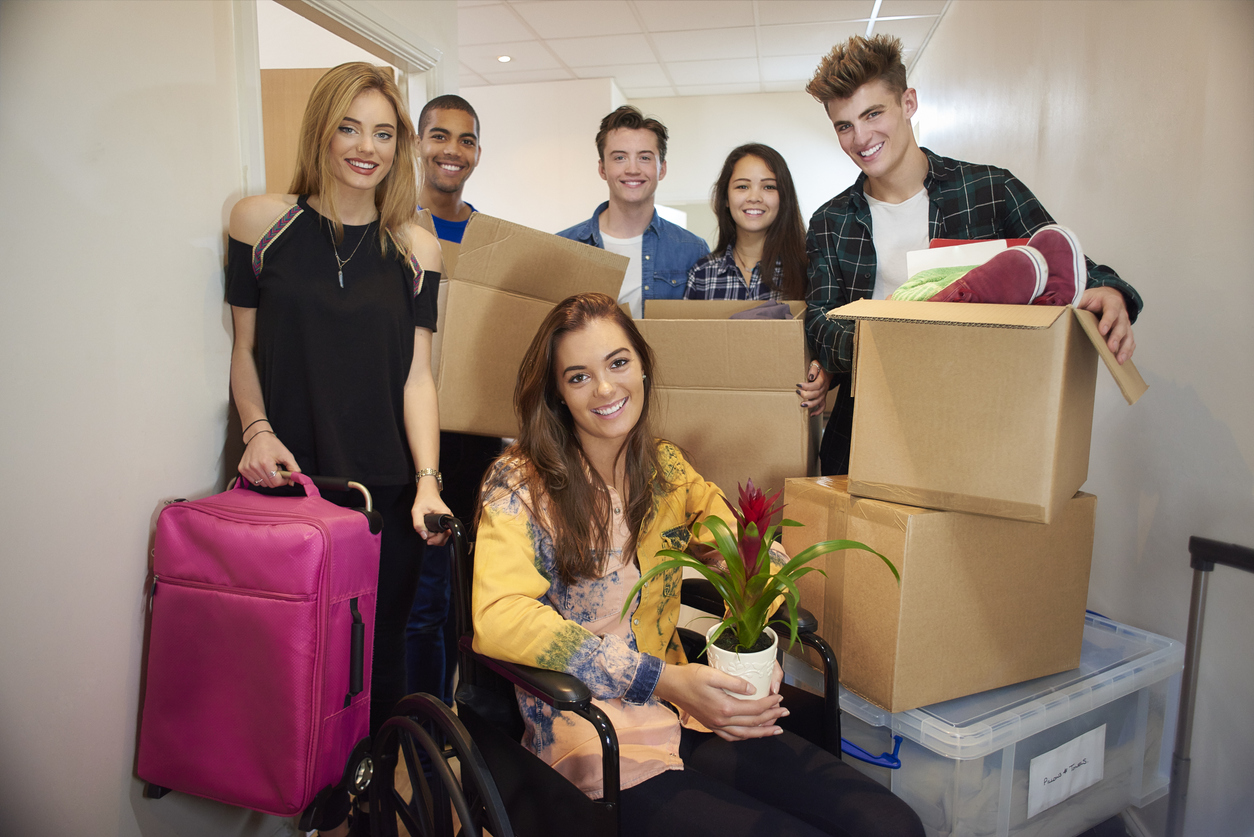 Students just moved into a new flat holding boxes