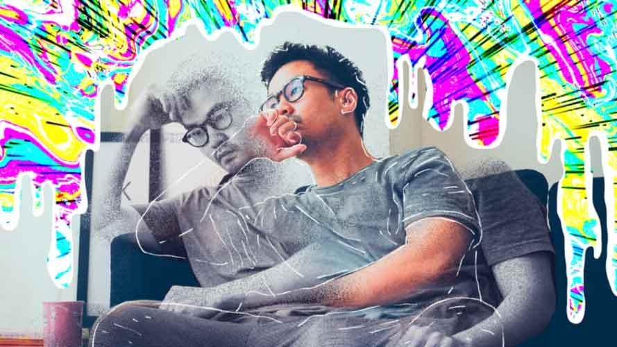 Imagem de homem sentado, preocupado, com sintomas de inquietação da ansiedade.