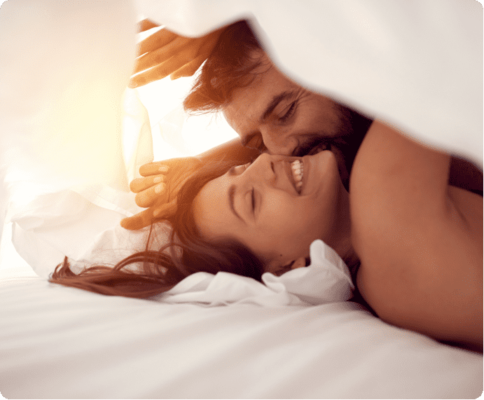 Couple in bed under blanket