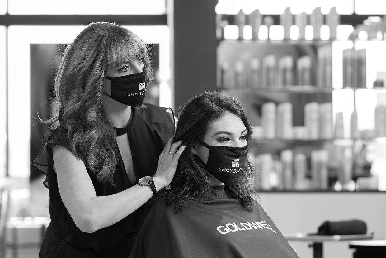 Shear Ego staff member and client wearing a mask.
