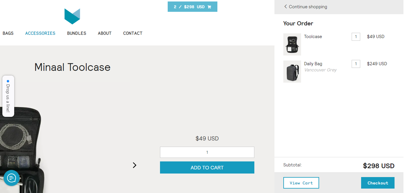 Minaal Toolcase product page with the mini cart display open on the far right. The order so far has a Toolcase and a Daily Bag in Vancouver gray.
