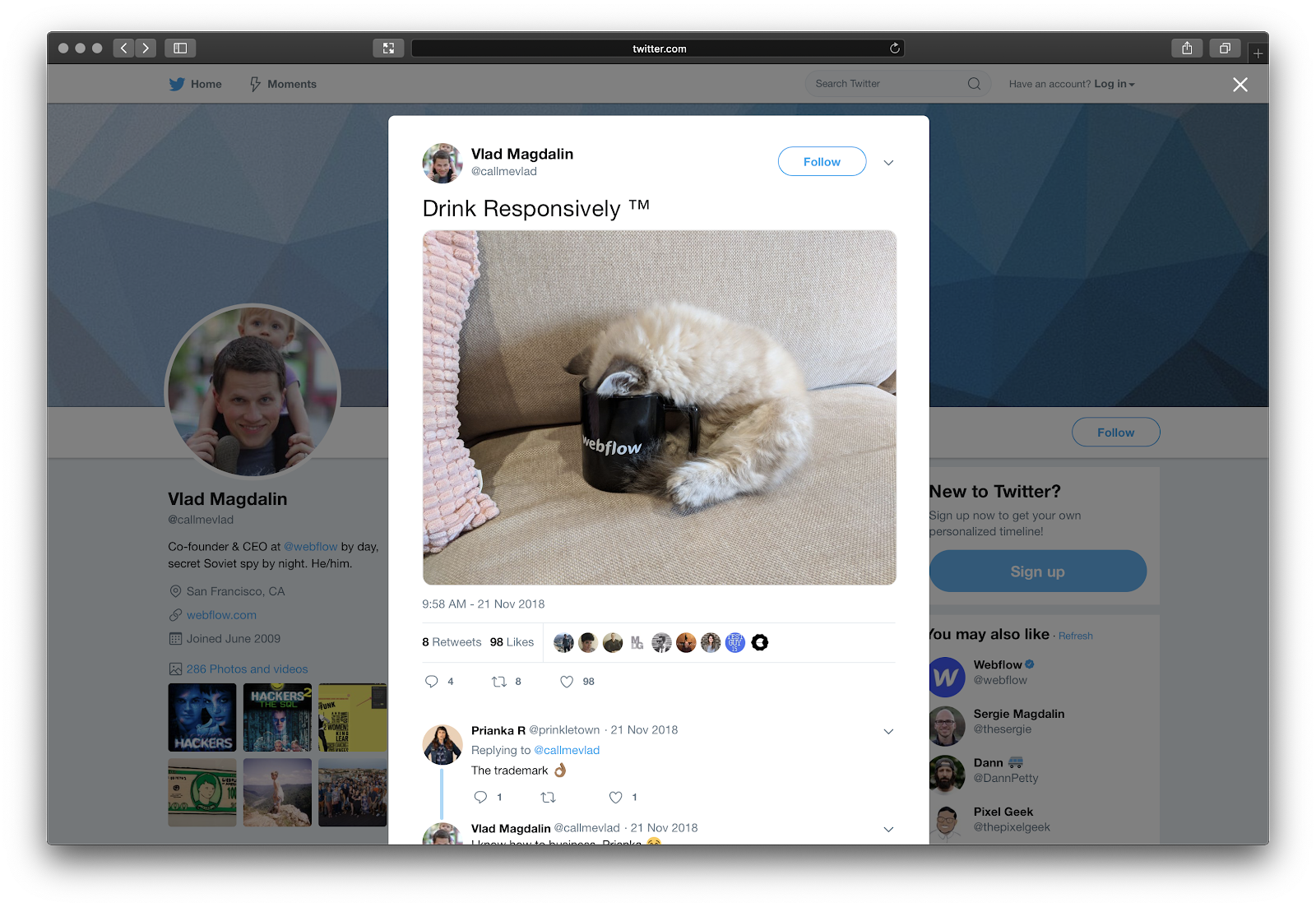 """Tweet by Vlad Magdalin with a picture of a kitten with its head in a Webflow branded mug and a caption that says, """"Drink Responsively"""""""