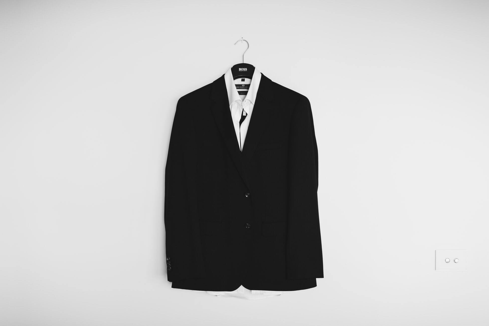 tailored suit hanging on wall