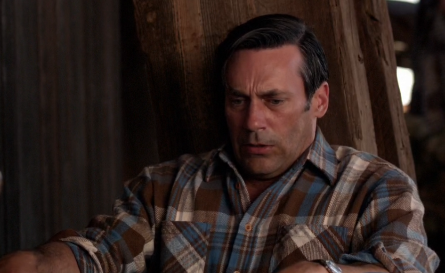 Don Draper in a flannel plaid shirt looking panicked.