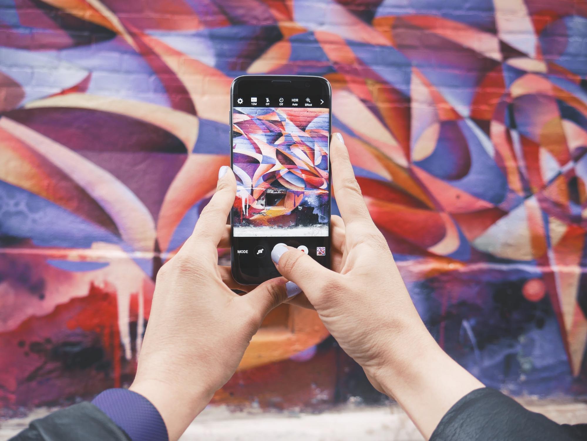 Taking a photo of graffiti