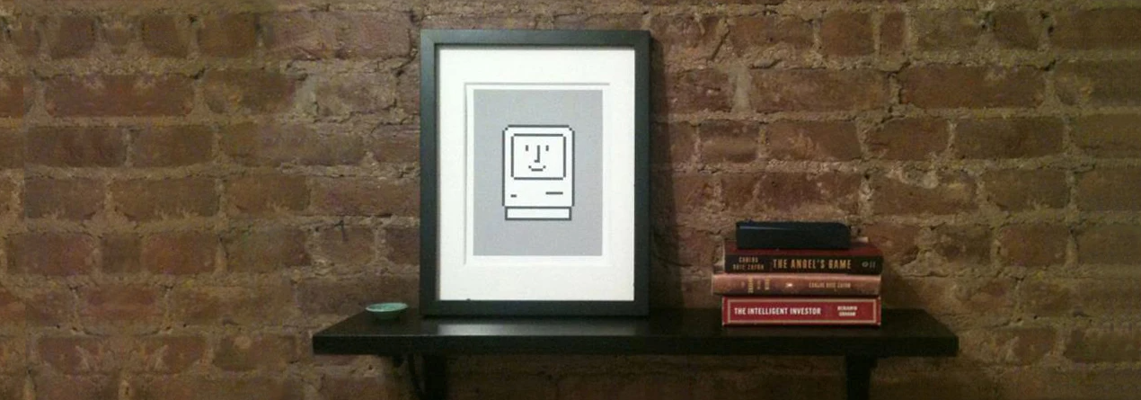 Framed print of smiling mac icon.