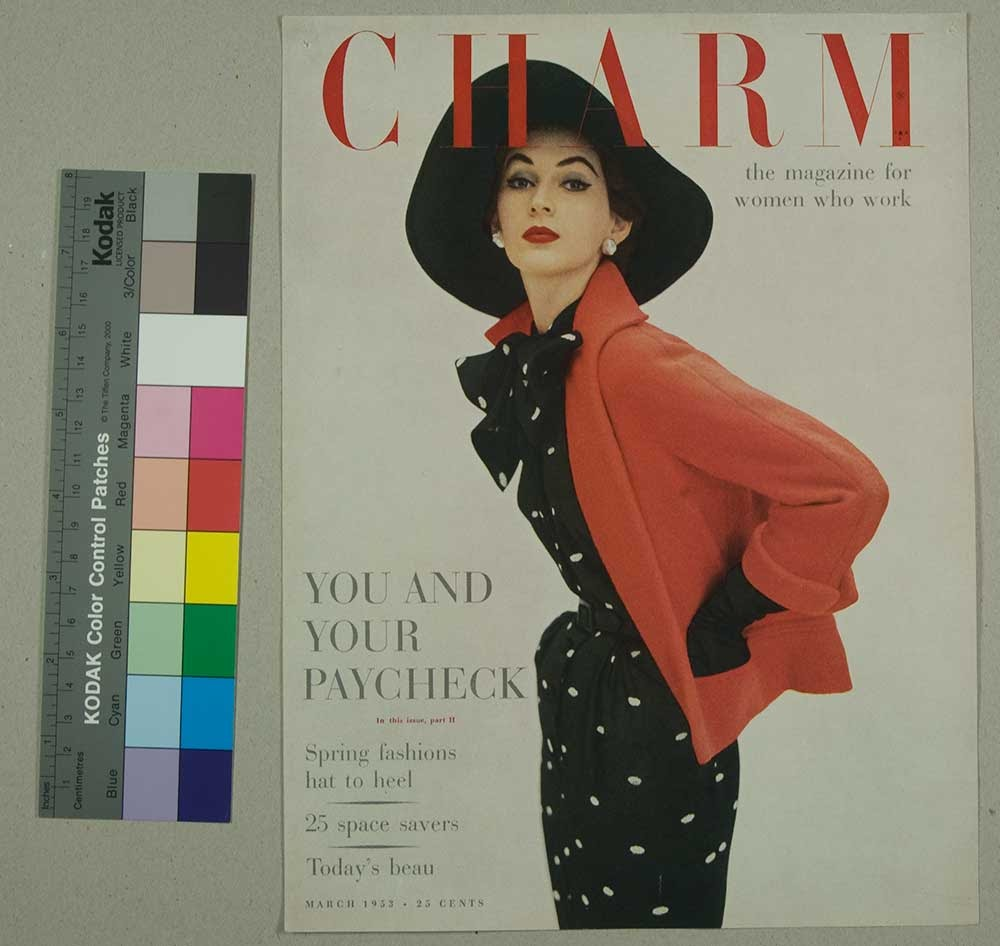 Charm Magazine cover featuring woman in hat with polka dot dress and red coat by Cipe Pineles.