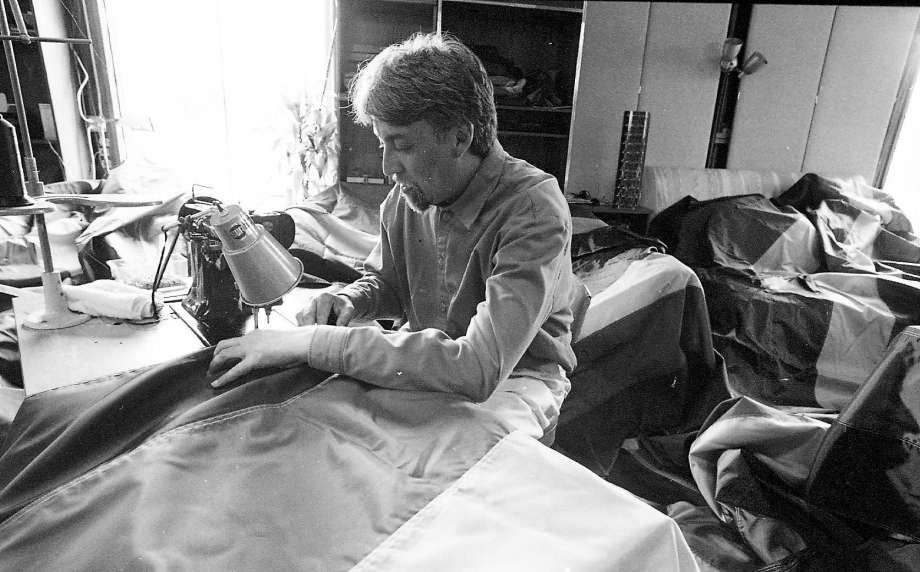 An image of Gilbert Baker sewing pride flags in 1998.