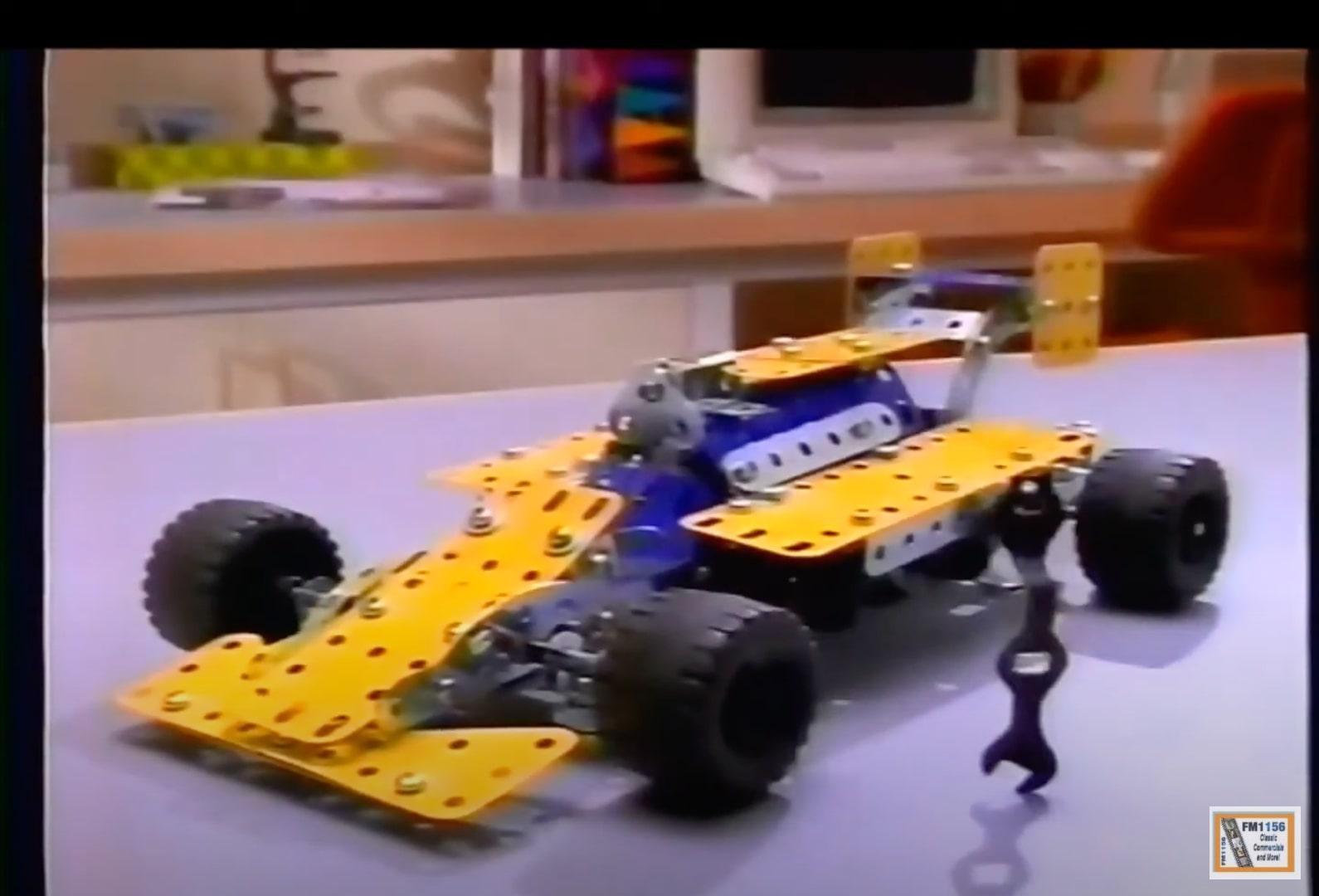 An image of a car built from an erector set.