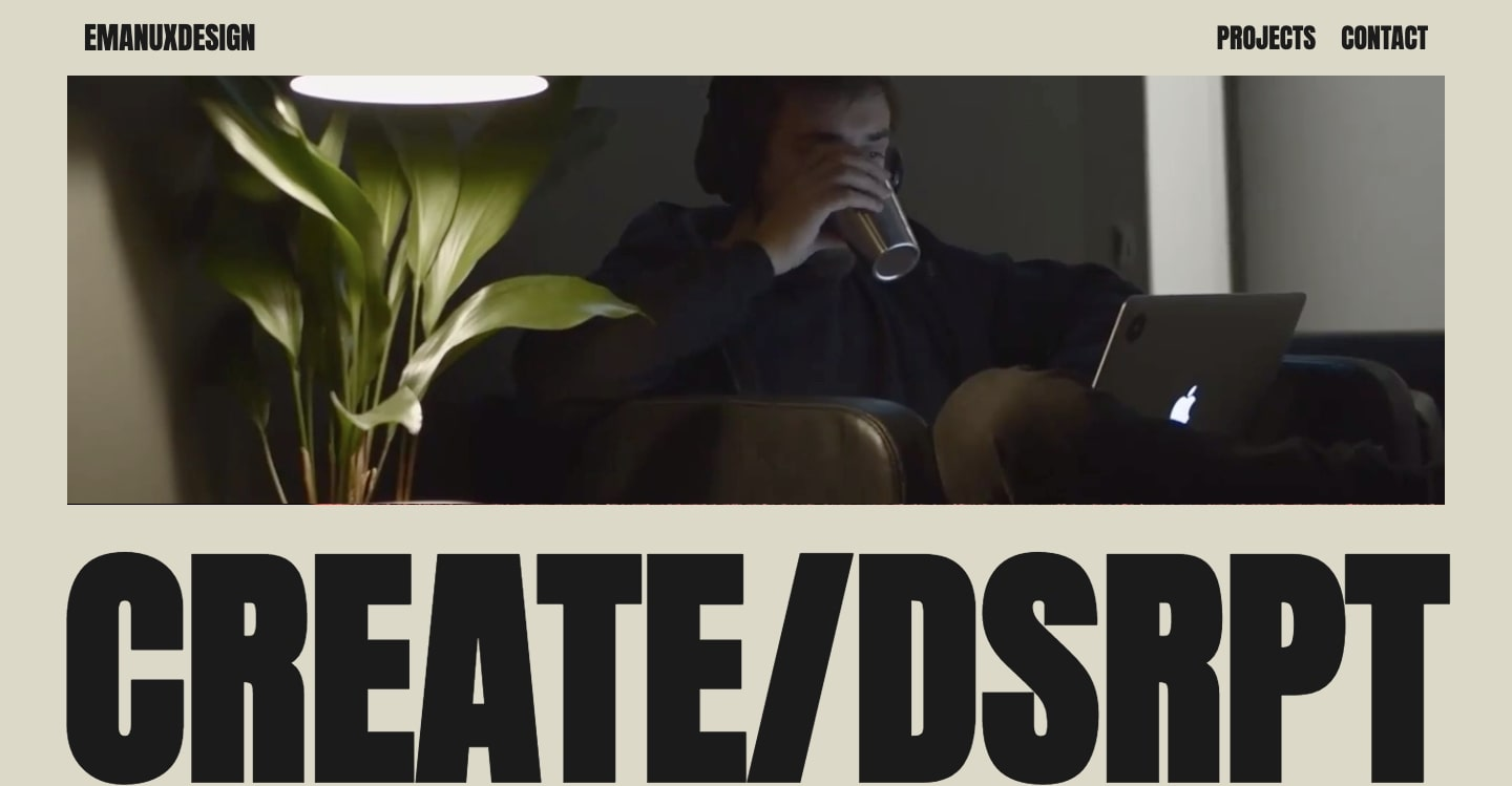 Screenshot of Create/Disrupt studio showing a person sitting on a couch with a mac laptop