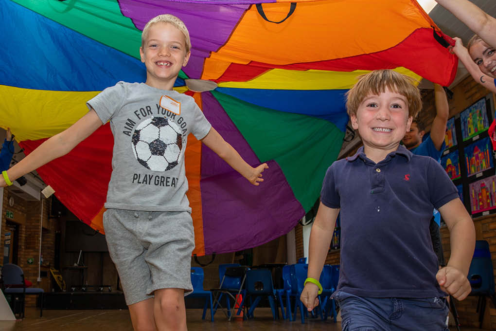 2 boys children parachute game