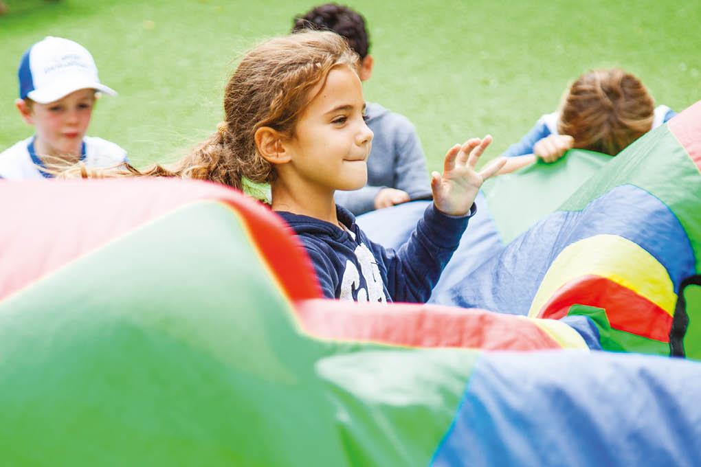 Parachute games girl smiling