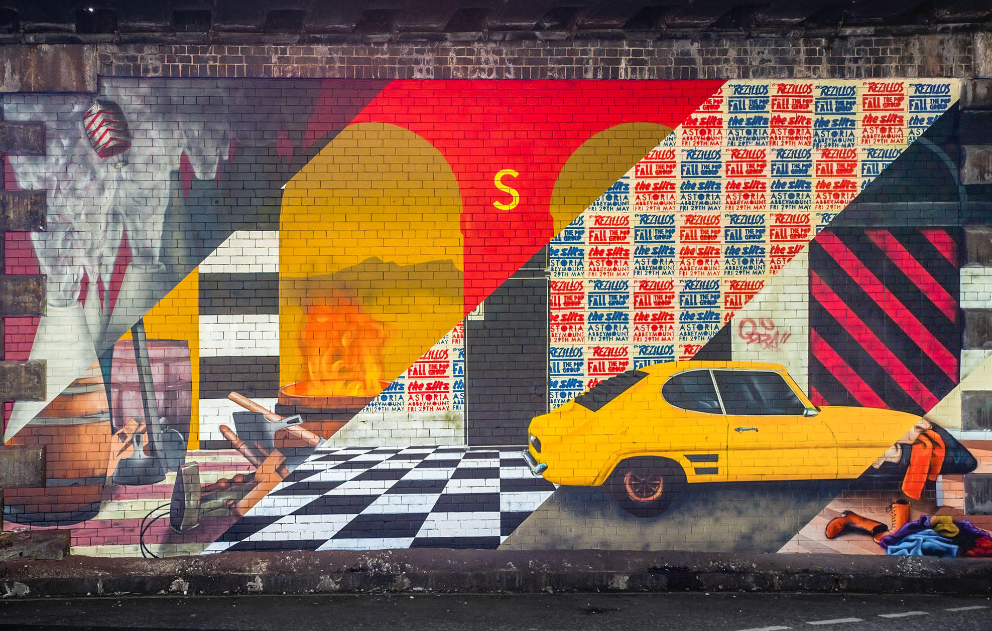 This bold mural is colourful and shows a yellow car