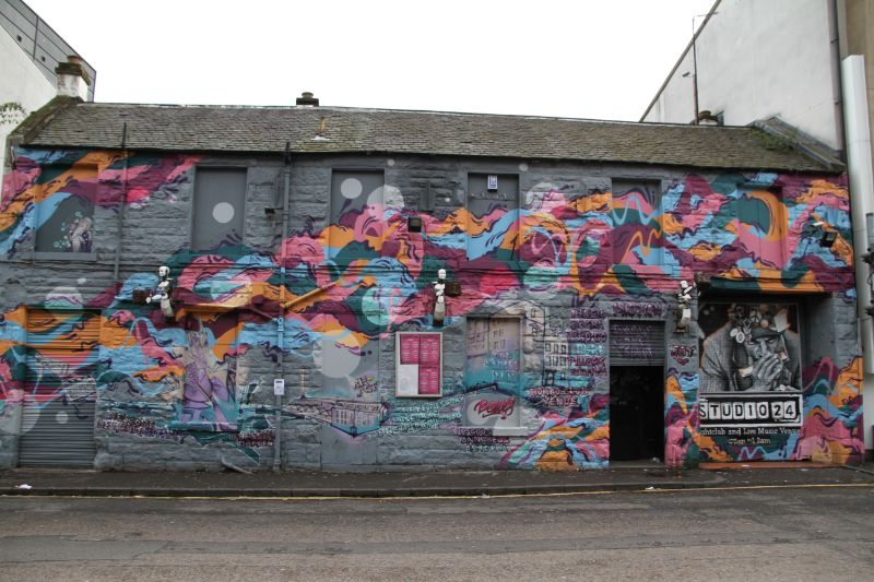 Studio 24 is a grey building with a colourful sweeping design painted on the front