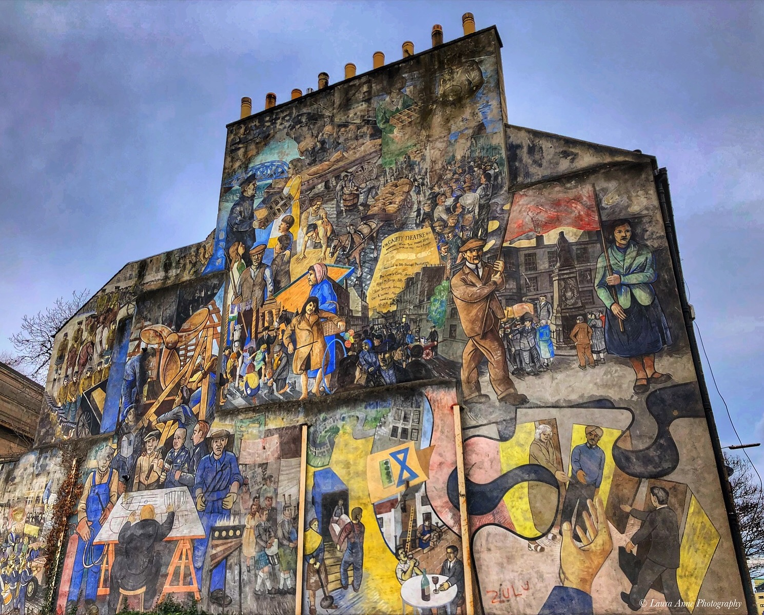 This mural covers the whole side of a building and depicts the history of Leith through colourful artwork