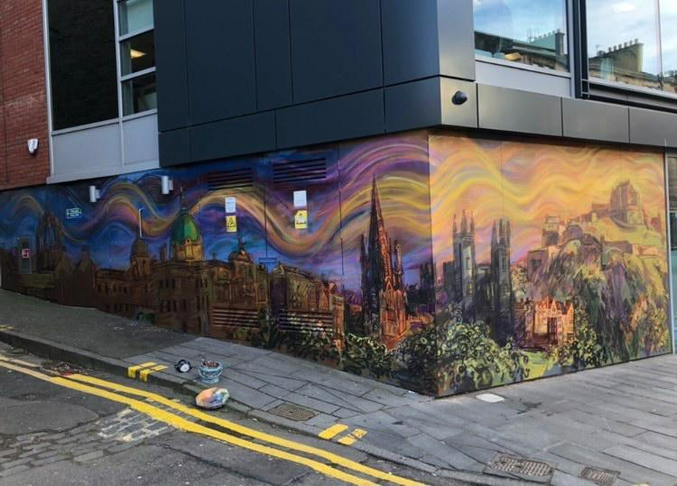 Chris Rutterford's design shows the Edinburgh skyline with swirling clouds above on the side of the building