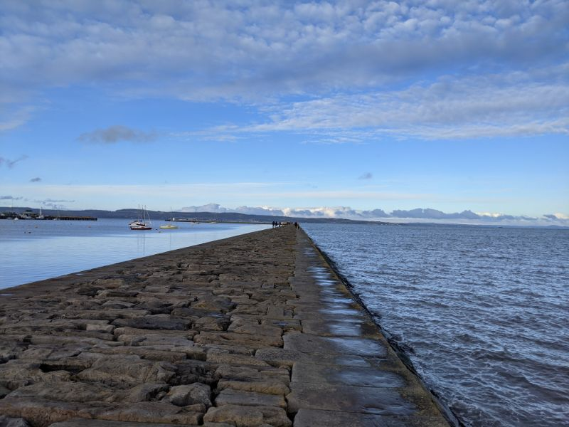 View looking out along the breakwater from Wardie Bay onto the Firth of Forth