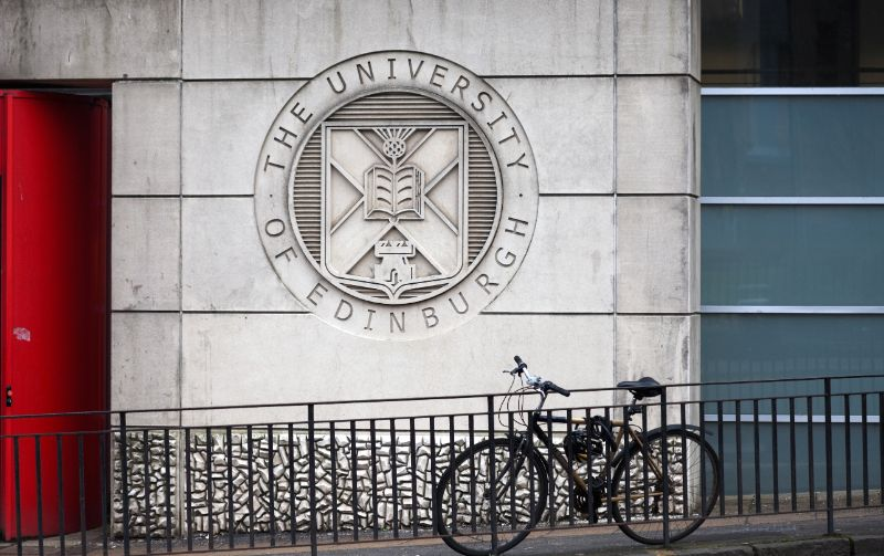 The University of Edinburgh logo on wall