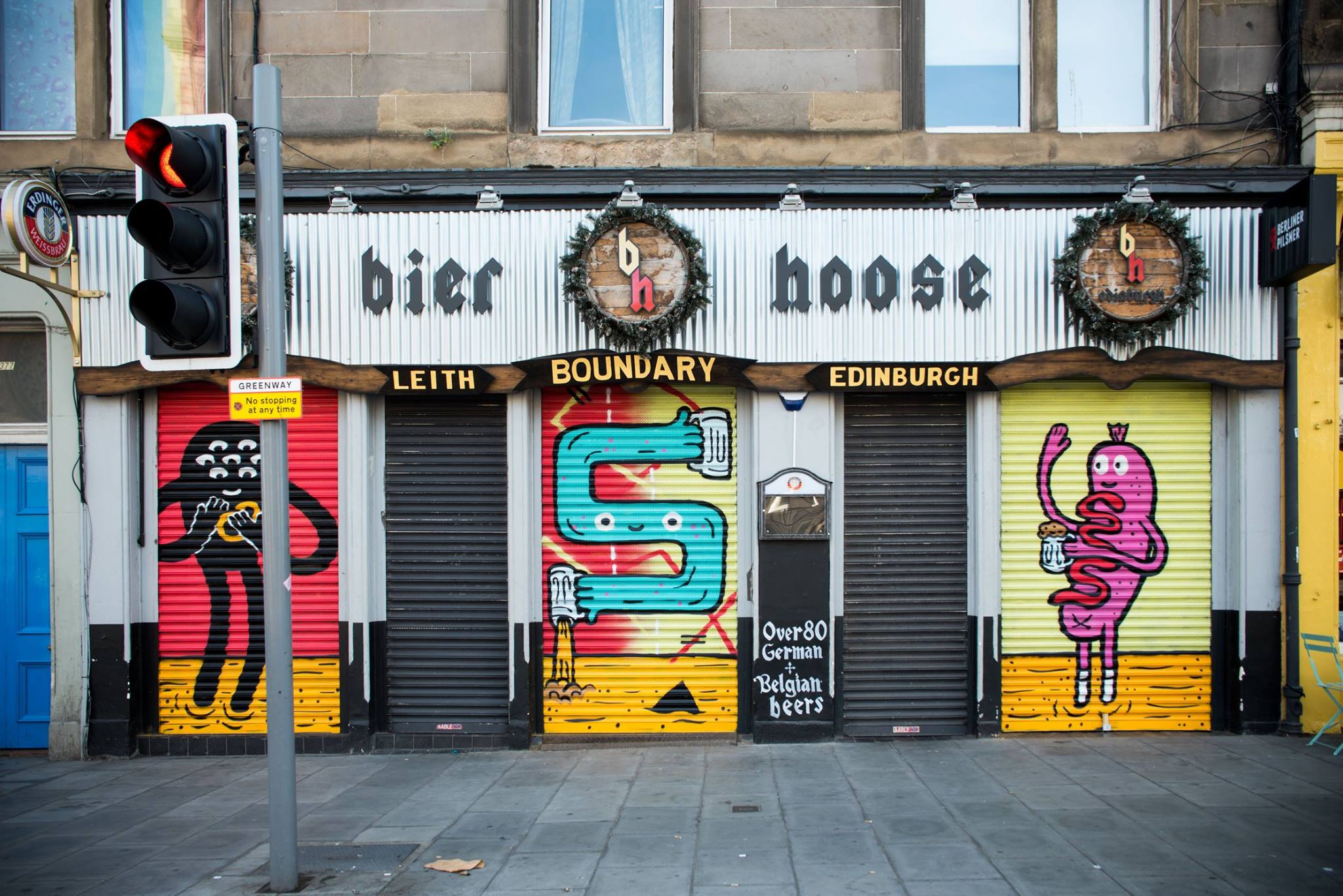 Colourful art on the shutters of the Bier Hoose pub