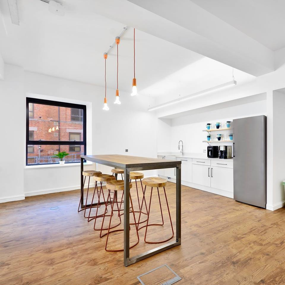 Bright communal kitchen area in office