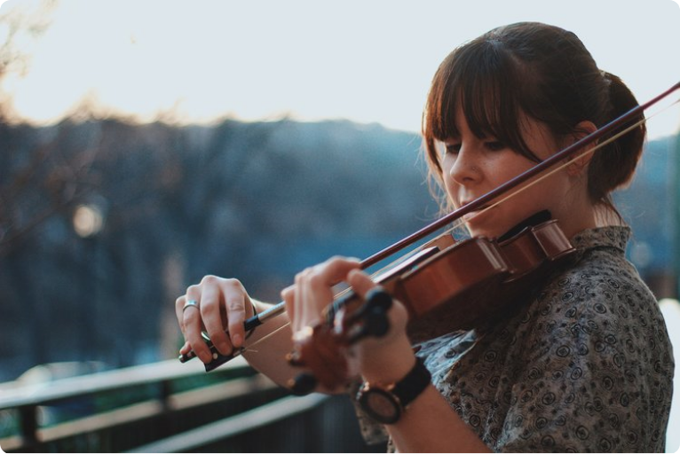 violinist playing with a natural background