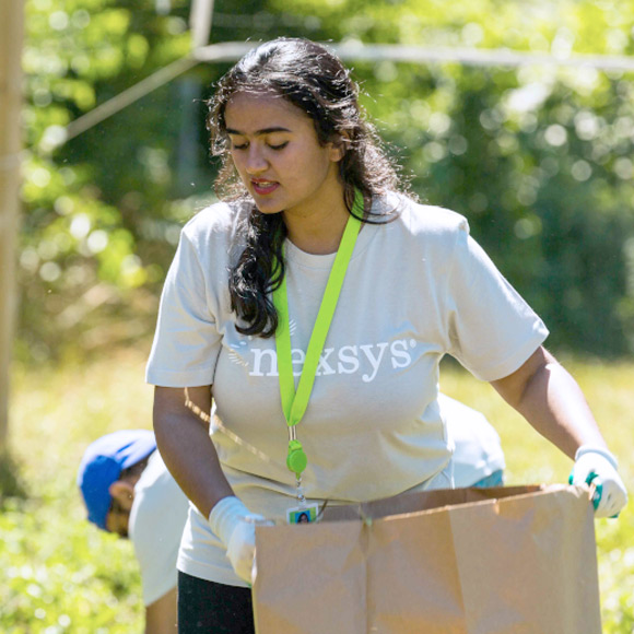 Nexsys team member at an outdoor community volunteer event