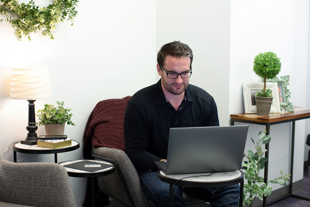 Man completing a digital closing on laptop