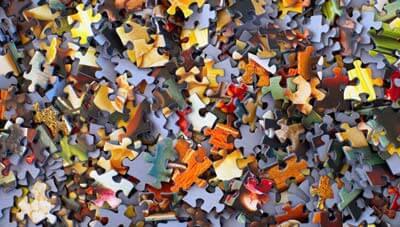 What are Puzzle Lapel Pins? | custompinsnow.com