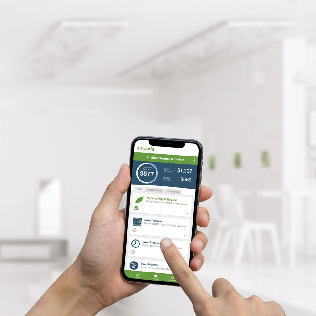 Photograph of a consumer using Emporia Energy's mobile app to measure and manage energy use.