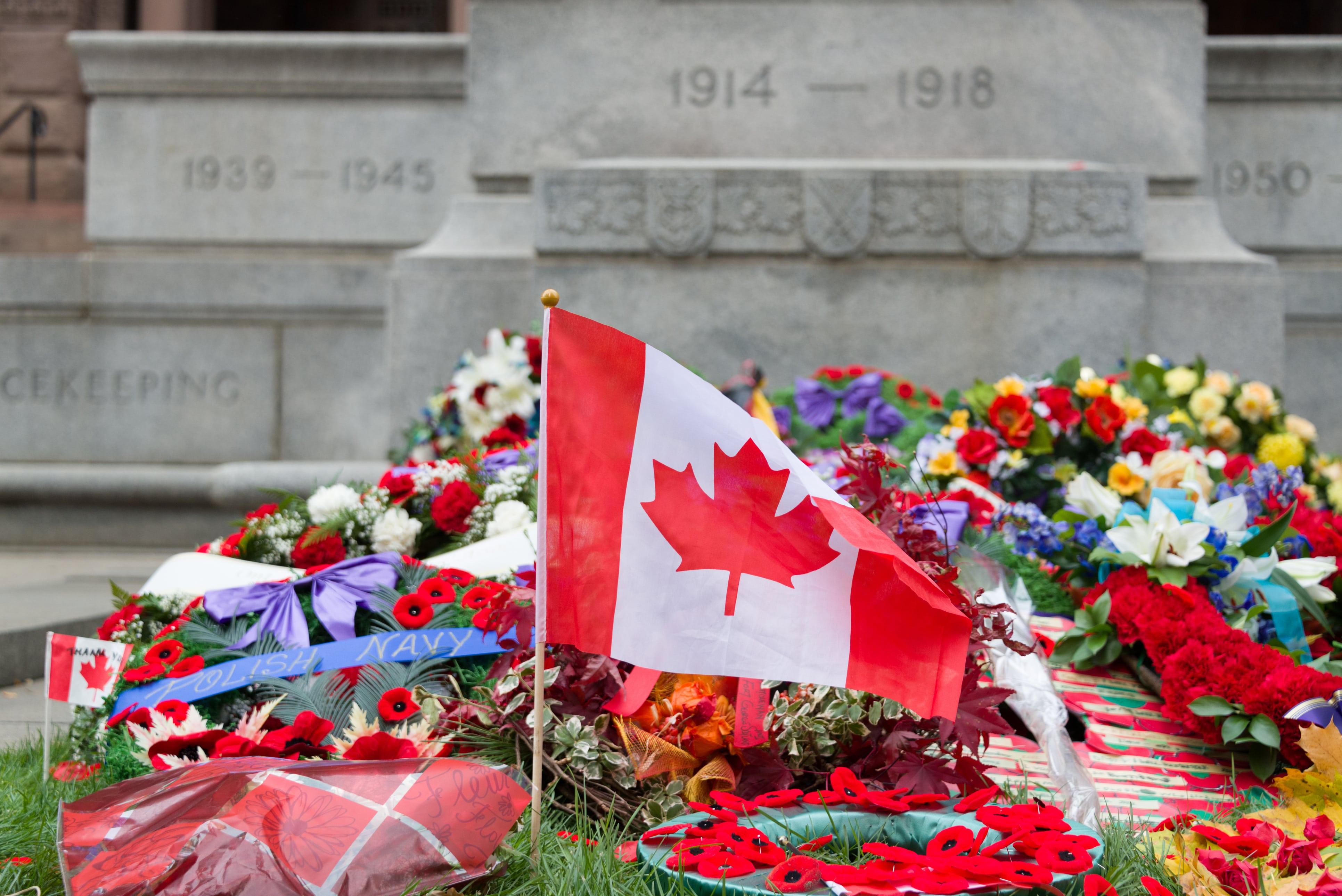Canadian flag laid amongst wreaths