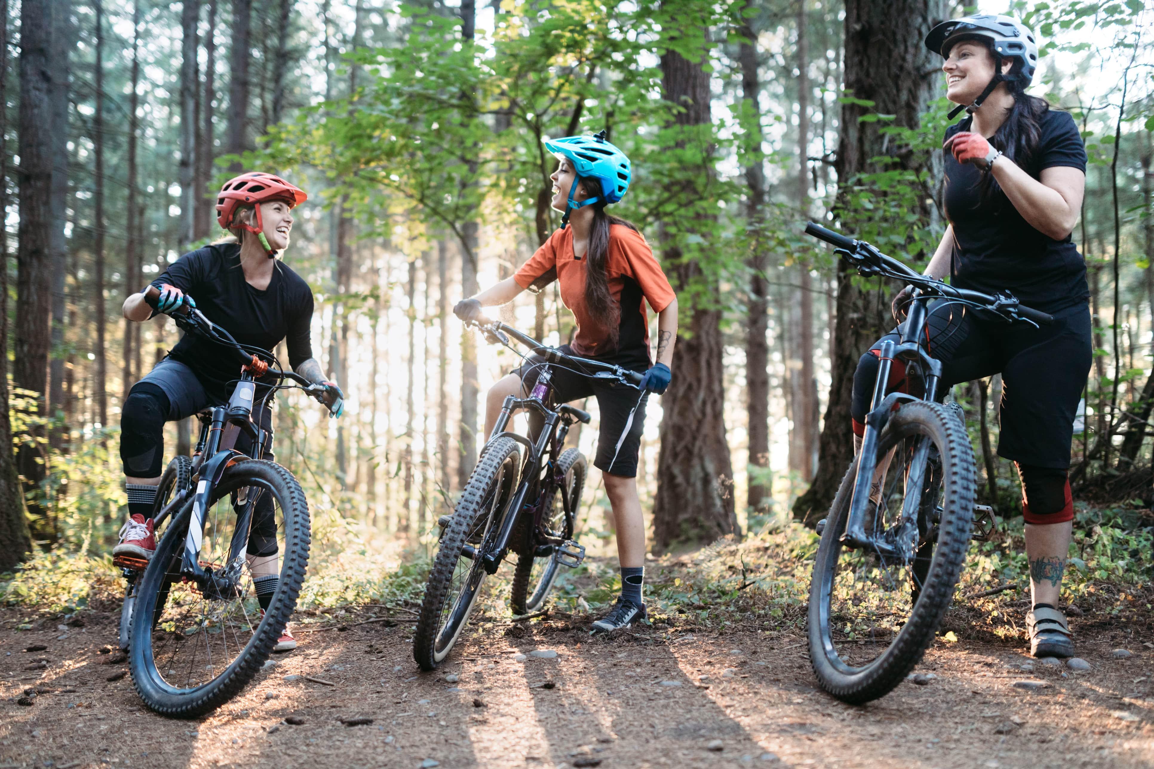 Women posing with mountain bikes