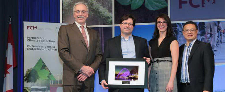 Jamie accepting the PCP Spirit Award at the Sustainable Communities Conference in London, ON, in February 2015.