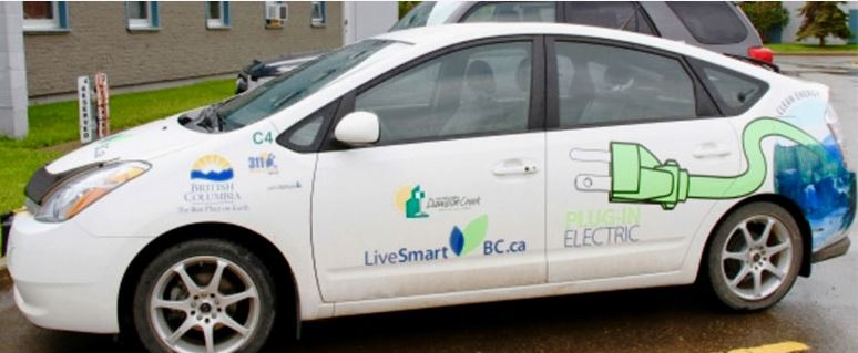 """Image of electric vehicle with logo """"Live smart BC"""""""